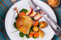 Duck on spinach, potato, apple sauсe and carrot Royalty Free Stock Photography
