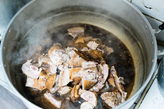 Duck stewed with gravy in hot stainless pot ready for make a sacrifice to gods on Chinese new year day Stock Image