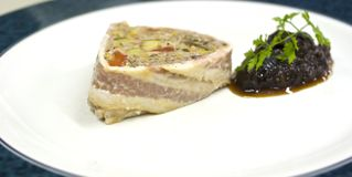 Duck terrine. Duck liver terrine in unusual triangular shape with fruit chutney and herbs stock photo
