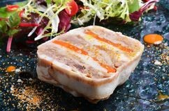 Duck terrine. With salad on dark slate Royalty Free Stock Photography