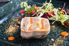 Duck terrine. With salad on dark slate Stock Photos