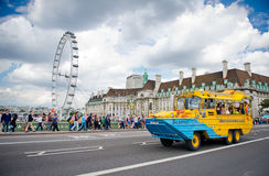 Duck tour bus with London Eye in background Royalty Free Stock Image
