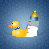 Duck toy with bottle for Newborn Royalty Free Stock Photography