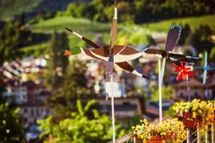 Duck vane on a balcony. Against green village in Italy royalty free stock photography