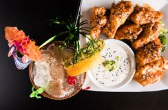 Duck wings with Tiki drink stock photos