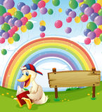 A duck beside the wooden board with floating balloons and a rain Royalty Free Stock Photos