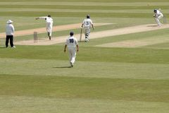 Ducking the bouncer. Scene at First Class English cricket match Royalty Free Stock Photography