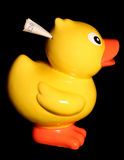 Duckling money box with twenty pound note Royalty Free Stock Image