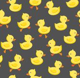 Ducklings, seamless pattern, color, gray, vector. Yellow ducklings on a gray field. Seamless pattern. Color, flat vector picture. Funny ducklings royalty free illustration