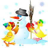 Ducklings and snowman Royalty Free Stock Photography