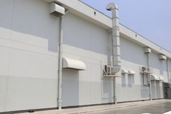 Duct for air conditioning systems. Ventilation chimneys of indoor machinery. The duct of the air conditioning system is installed on the side of the building royalty free stock images