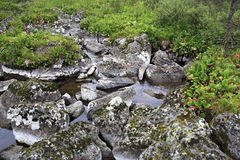 Duct with stones between the fifth and sixth. Karakol lakes. Republic of Altai royalty free stock photography
