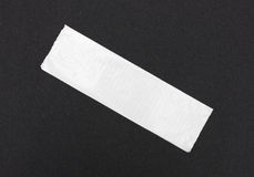 Duct tape on black craft paper Royalty Free Stock Photo