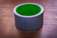 Duct tape on brown wooden board construction Stock Images