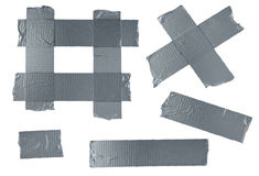 Duct Tape  Elements. Duct tape or duck tape torn strips of  elements of strong adhesive gray material used in packaging boxes or repairing or fixing broken Stock Photos