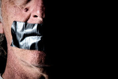 Duct tape over mouth of man Royalty Free Stock Photo