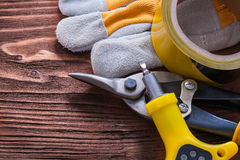Duct tape screwdriver protective glove and nippers Royalty Free Stock Image