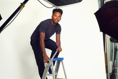Duct tape technician photographer studio work young man working Stock Photography