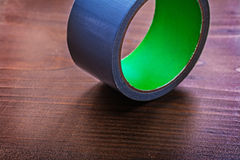 Duct tape on vintage brown wooden board Royalty Free Stock Photos