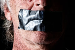 Duct taped mouth close up Stock Photography