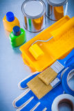 Duct tapes protective gloves paint brushes roller Stock Photo