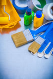 Duct tapes safety gloves and paint tools on Stock Photography