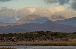 English Lake District Mountains from the Cumbrian Coast. royalty free stock photography