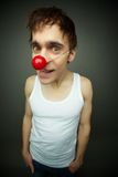 Dude. Close-up of a dude with a maniac look celebrating fool�s day stock images