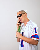 Dude Calling. A dude calls out to his bro, it's time to get the party started stock photo