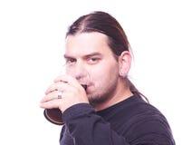 Dude drinking beer. Studio shot Royalty Free Stock Photography