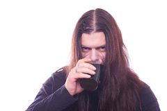 Dude with flowing hair drink beer Royalty Free Stock Image