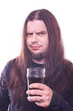 Dude with flowing hair holding beer glass Stock Images
