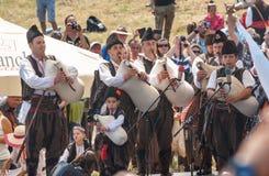 Dudelsackkapelle auf Stadium Festival Rozhen in Bulgarien Lizenzfreies Stockbild