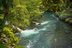 River in a momentary lull after passing the waterfall 8393. The Duden river below the falls royalty free stock photos
