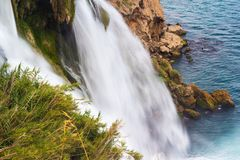 Duden Waterfall flows into the sea in the Antalya from Turkey, close-up stock image