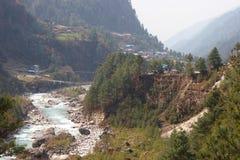 Dudh Kosi river, Everest trek, Himalayas, Nepal. Suspension bridge across Dudh Kosi river at Phakding village, Everest trek, Himalayas, Nepal Royalty Free Stock Photography