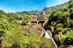 Dudhsagar Falls. Waterfall in goa with railway bridge through the middle Stock Photography