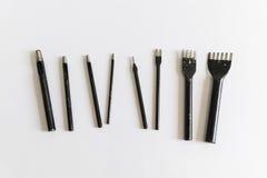 Dudniący poncza set, osiem kawałków na białym tle, narzędzia dla pu Obrazy Stock