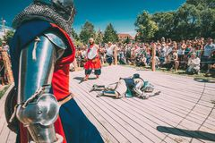 Knights In Fight With Swords. Restoration Of Knightly Battle. Dudutki, Belarus - July19, 2014: Historical restoration of knightly fights on festival of medieval royalty free stock image