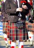 Dudziarz w szkockiej kraty kilt Obrazy Royalty Free