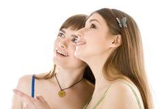Due adolescenti che osservano in su Fotografia Stock Libera da Diritti
