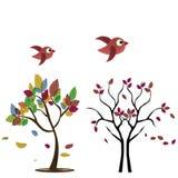 Due alberi con gli uccelli Immagini Stock