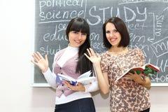 Due allievi con i libri Fotografia Stock Libera da Diritti