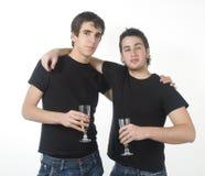 Due amici che bevono champagne Fotografia Stock