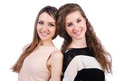 Due amici femminili isolati Fotografia Stock