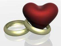 Due anelli di cerimonia nuziale con cuore. Immagini Stock Libere da Diritti