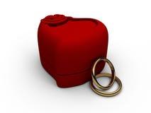 Due anelli dorati su priorità bassa bianca Immagine Stock