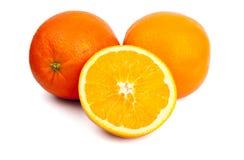 Due arance ed a metà nella parte anteriore Immagini Stock Libere da Diritti