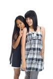 Due asiatici che hanno un segreto Fotografia Stock