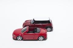 Due automobili del giocattolo immagini stock